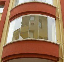Балконы безрамное остекление